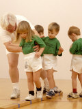 Kids in Exercise Class with Instructor Photographic Print by Matthew Borkoski