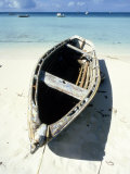 Wooden Row Boat Lying on Beach Photographic Print by Lee Peterson