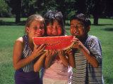 Children in Park Eating Watermelon Photographie par Mark Gibson