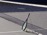 Tennis Racquet Against Net with Ball Impresso fotogrfica por Mitch Diamond