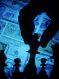 Hand Holding Chess Piece in Front of Currency Fotografisk trykk av Gary Conner