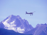 Aircraft in Flight Over Mountain, Haines, Alaska Photographic Print by Roger Holden