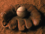 Baseball Glove with Ball on Dirt Photographic Print by John T. Wong