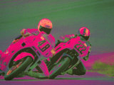 Two People Racing Motorcycles Photographic Print by Harold Wilion