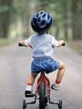 Little Boy Riding His Bicycle with Helmet Reproduction photographique par David Davis