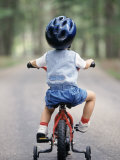 Little Boy Riding His Bicycle with Helmet Photographic Print by David Davis