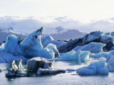 Icebergs Calved from Breidamerkurjokull Glacier Floating in Lake Jokulsarlon, Iceland Photographic Print by Richard Packwood