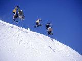 Snowboarders Jumping off Overhang, CO Fotografisk tryk af Kurt Olesek