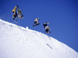 Snowboarders Jumping off Overhang, CO Photographic Print by Kurt Olesek