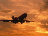 Silhouette of Commercial Airplane at Sunset Photographic Print by Mitch Diamond