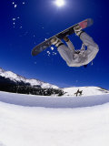 Snowboarder Upside Down in Midair Photographic Print by Kurt Olesek