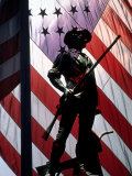 US Flag with Silhouetted Statue of Soldier Photographic Print by Whitney & Irma Sevin