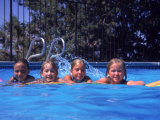 Girls on Float in Pool Photographic Print by Mark Gibson