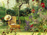 Summer Garden in France with Cane Seat with Stand of Purple Echinops and Pleached Apple Tree Photographic Print by Martine Mouchy