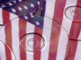 Cds with Reflection of American Flag Photographic Print by Jim Corwin