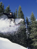Airborne Man on Snowboard Photographic Print by Kurt Olesek