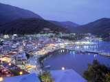 Town & Harbor at Night, Epirus, Greece Photographic Print by Walter Bibikow