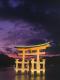 Floating Torii with Dark Clouds, Japan Photographic Print by Walter Bibikow