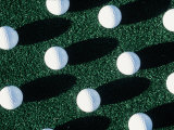 Golf Balls on Grass Photographic Print by Guy Crittenden