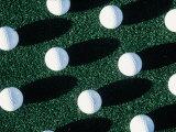 Golf Balls on Grass Photographic Print by Guy Crittenden