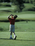 Young Boy Playing Golf, Breckenridge, CO Photographic Print by Bob Winsett