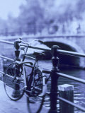 Bicycle on Rail by Canal, Amsterdam, Netherlands Photographic Print by Walter Bibikow