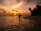Silhouetted Couple, Felidu Atoll, Maldives Photographic Print by Stuart Westmorland