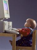Baby Sitting at Desk Using Computer Photographic Print by Kevin Leigh