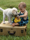 Baby Girl Playing with Puppy Photographic Print by Chris Lowe