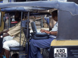Man Uses Laptop in Back Seat of Rickshaw, India Photographic Print by Steve Starr