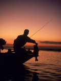 Silhouette of Bass Fisher at Sunset Photographie par Timothy O'Keefe
