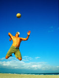 Man Playing Volleyball, FL Photographic Print by Jeff Greenberg