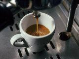 Machine Pouring Cup of Espresso Fotografisk trykk av John Dominis