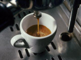 Machine Pouring Cup of Espresso Photographic Print by John Dominis