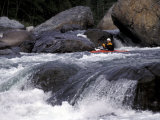 White Water Kayaker Preparing for Steep Rapids Photographic Print by Kevin Beebe