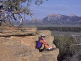 Woman Mountain Biking, Sitting Photographic Print by Amy And Chuck Wiley/wales