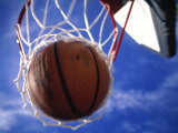 Basketball in Hoop Photographic Print by Mitch Diamond