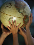 Kids Holding Globe Photographic Print by Guy Crittenden