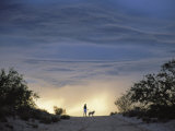 Silhouette of Woman and Dog, Thunderhead, Tucson, Photographic Print by Frank Staub