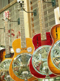 Showcase Displaying Dobro Resonating Guitars Photographic Print by Barry Winiker