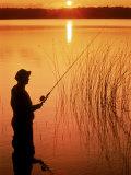 Silhouette of Man Fishing, Vilas City, WI Photographic Print by Ken Wardius