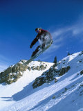 Person Holding Snowboard While Jumping Photographic Print by Rob Gracie