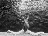 Woman Relaxing in Swimming Pool Photographic Print by Jack Affleck