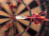 Dart in Bull's Eye on Dart Board Photographic Print by John James Wood