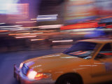 Blurred View of Taxi Cab in Times Square, NYC Photographic Print by Rudi Von Briel
