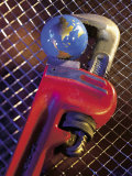 Wrench Holding Globe Photographic Print by Ellen Kamp