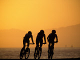 Silhouette of Three Men Riding on the Beach Photographic Print by Mitch Diamond