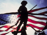 Silhouette of Soldier in Front of Flag Photographic Print by Whitney & Irma Sevin