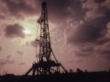Silhouette of an Oil Rig at Sunset Photographic Print by William Swartz