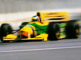 Yellow Race Car in Motion Fotografie-Druck von Peter Walton